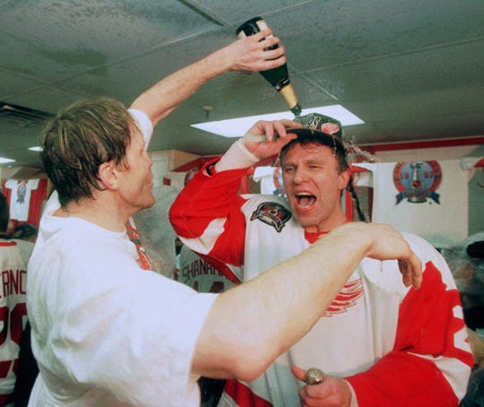 "FILE--Detroit Red Wings' Vladimir Konstantinov, left, douses Viacheslav Fetisov, right, with champagne after they won the Stanley Cup in this June 7, 1997 file photo in Detroit.  Nearly a decade after arriving in the United States, Fetisov helped Detroit win the 1997 Stanley Cup championship.  Now, the Red Wings are poised to repeat, up 2-0 on the Washington Capitals.  After that, he might consider retirement. ""I feel good, but I know I have to stop sometime from playing hockey,'' Fetisov said."