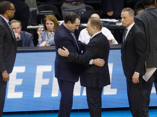 Duke coach Mike Krzyzewski, left, congratulates Michigan State coach Tom Izzo, right, after MSU beat Duke in the NCAA tournament East Region final on Sunday, March 31, 2019, in Washington.