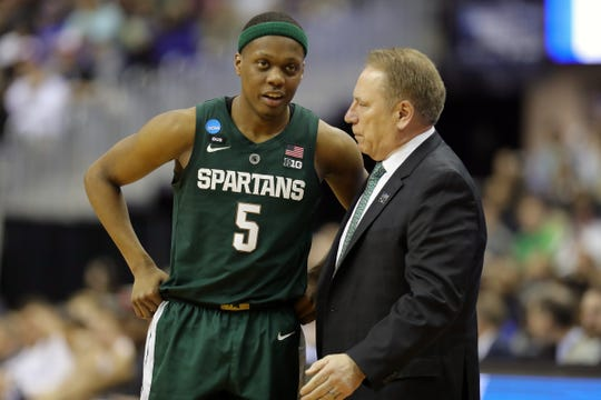 Cassius Winston talks with coach Tom Izzo during MSU's 68-67 win in the NCAA tournament East Region final Sunday.