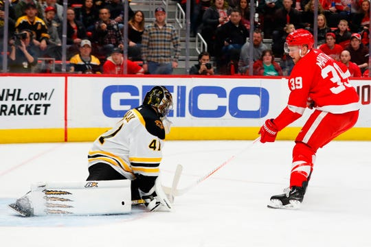 Bruins goaltender Jaroslav Halak makes the save on Red Wings right wing Anthony Mantha in the second period of the Wings' 6-3 win on Sunday, March 31, 2019, at Little Caesars Arena.