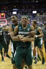 Michigan State's Aaron Henry and Cassius Winston celebrate after Michigan State celebrates after MSU's 68-67 win in the NCAA tournament East Region final on Sunday, March 31, 2019, in Washington.