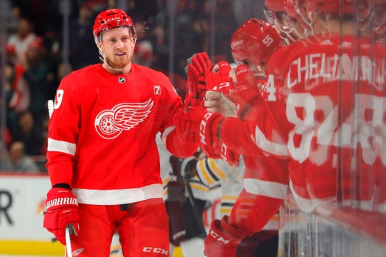 Red Wings right wing Anthony Mantha is congratulated by teammates after scoring in the first period of the Wings' 6-3 win on Sunday, March 31, 2019, at Little Caesars Arena.