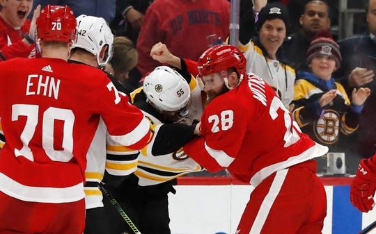 Boston Bruins center Noel Acciari (55) and Detroit Red Wings right wing Luke Witkowski (28) fight during the second period of an NHL hockey game, Sunday, March 31, 2019, in Detroit.
