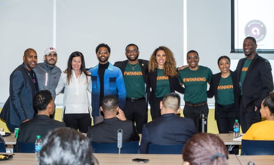 """The Moguls in the Making winners from Florida A&M University pose with competition judges and their mentor on Sunday, March 31, 2019 in Detroit. Pictured left to right: George Spencer, executive vice president of business development, Innovation and Entrepreneurship at the TMCF, Carlos Rodriguez, team mentor from Ally Financial, Andrea Brimmer, chief marketing and public relations office at Ally Financial, Sean """"Big Sean"""" Anderson, Emmanuel Dawson, Nalani Kelley-Marsh, Earl Perry, Livi Grant, Keishon Smith."""