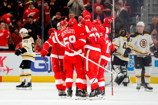 Red wings right wing Anthony Mantha (39) congratulated by teammates after scoring in the first period against Boston Bruins at Little Caesars Arena.