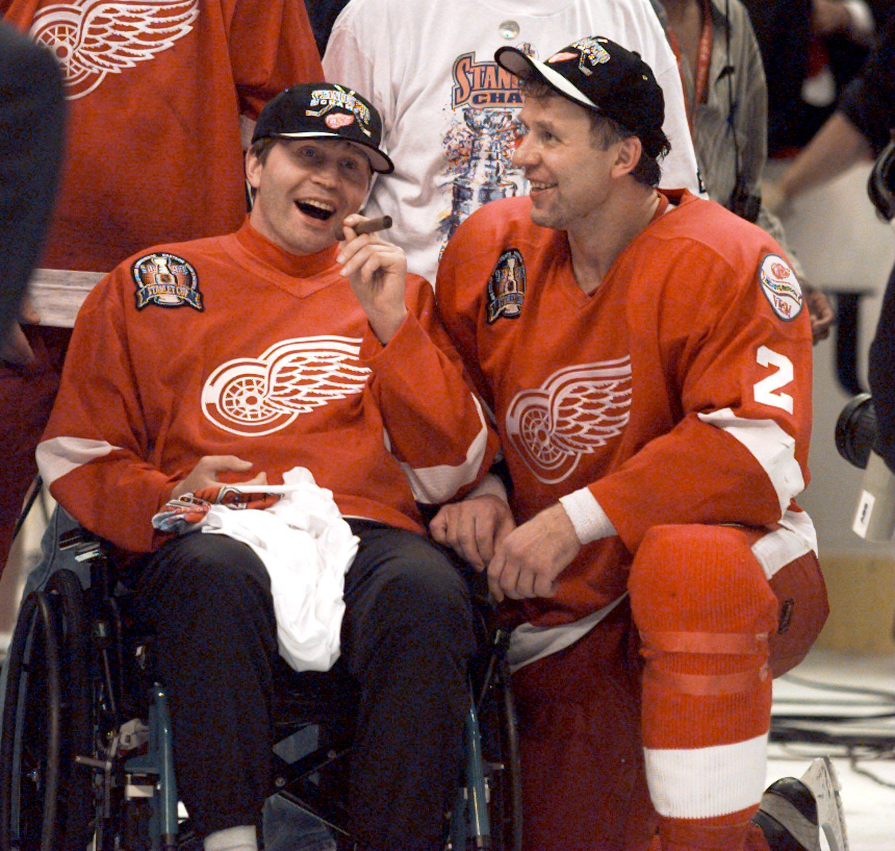 Vladimir Konstantinov and Viacheslav Fetisov on the ice after winning the Stanley Cup in Washington, D.C. Tuesday, June 16, 1998.