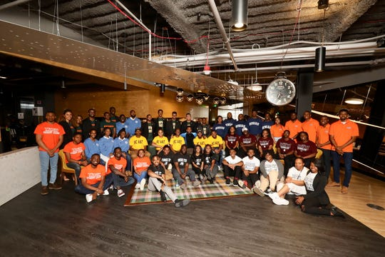 """The fifty student participants in Moguls in the Making pose with Sean """"Big Sean"""" Anderson (center) on Sunday, March 31, 2019."""