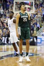 Michigan State's Kenny Goins celebrates during MSU's 68-67 win in the NCAA tournament East Region final on Sunday, March 31, 2019, in Washington.