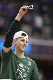 MSU's Matt McQuaid cuts down the net after MSU's 68-67 win in the NCAA tournament East Region final on Sunday, March 31, 2019, in Washington.