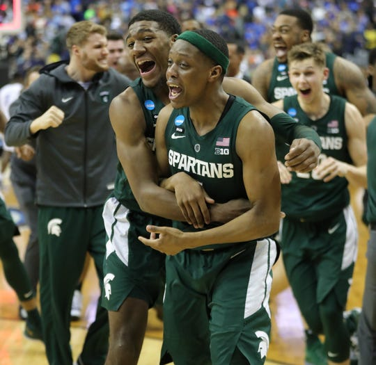 MSU's Aaron Henry and Cassius Winston celebrate after beating Duke in the NCAA Regional Final Sunday, March 31, 2019 at Capital One Arena in Washington, DC.