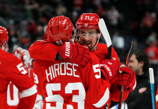 Red Wings left wing Taro Hirose is hugged by center Dylan Larkin after the third period of the Wings' 6-3 win over the Bruins on Sunday, March 31, 2019, at Little Caesars Arena.