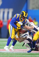 C.J. Anderson runs during Super Bowl LIII against the Patriots on Feb. 3.