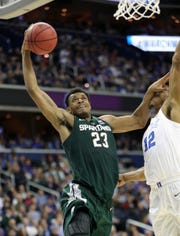MSU forward Xavier Tillman scores against Duke Javin DeLaurier during second half action of the  NCAA Regional Final Sunday, March 31, 2019 at  Capital One Arena in Washington, DC.