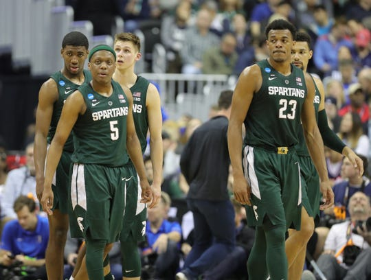 MSU players Aaron Henry,Matt McQuaid, Cassius Winston Xavier Tillman and Kenny Goins during MSU's 68-67 win in the NCAA tournament East Region final on Sunday, March 31, 2019, in Washington.