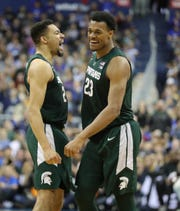 MSU forward Xavier Tillman celebrates with Kenny Goins after his dunk on Duke forward Javin DeLaurier during second half action of the  NCAA Regional Final Sunday, March 31, 2019 at  Capital One Arena in Washington, DC.