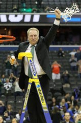 MSU coach Tom Izzo cuts down the net after his team beat Duke in the NCAA Regional Final Sunday, March 31, 2019 at Capital One Arena in Washington, DC.