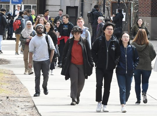 University of Michigan students walk to class on the campus in Ann Arbor.   The percentage of black student enrollment at all of Michigan's four-year public universities is the third worst in the nation, according to a report by The Education Trust.