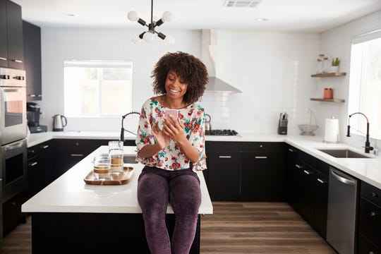 This year, we're breaking away from all-white kitchens, mixing up our metal fixtures and hardware, and letting our appliances cook while we catch up on our newsfeeds. (Dreamstime)