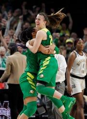 Oregon forward Satou Sabally, left, and Oregon guard Sabrina Ionescu, right, celebrate their regional final victory over Mississippi State.