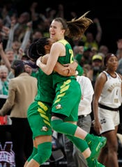 Oregon forward Satou Sabally, left, and Oregon guard Sabrina Ionescu, right, celebrate their regional final victory over Mississippi State.