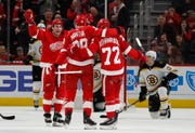 Teammates celebrate the second goal by Detroit Red Wings right wing Anthony Mantha (39) during the first period Sunday. Mantha had three goals and two assists in Detroit's 6-3 victory over Boston at Little Caesars Arena.
