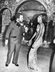 Motown Records founder Berry Gordy dances with Martha Reeves at a 1969 gala at his home in Detroit's Historic Boston-Edison District.