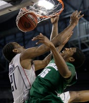 Michigan State's Durrell Summers (15) dunks the ball over Connecticut's Stanley Robinson (21) during a men's NCAA Final Four semifinal in 2009 in Detroit.