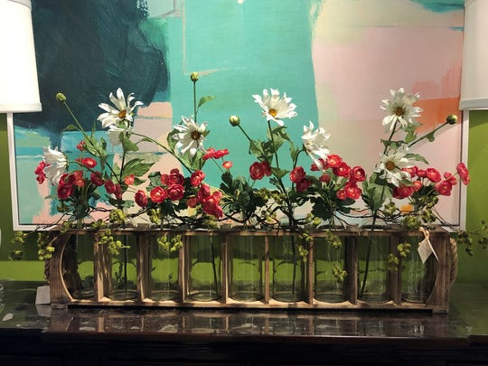 Nothing says spring like a bouquet of flowers. Pieces like this bottle display are great investments as they easily transform to match the seasons. (Handout/TNS)