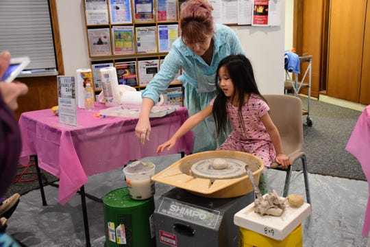 Hands-on pottery at the Festival of the Arts.