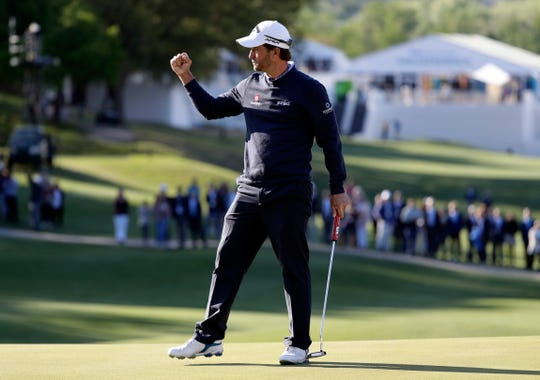 Kevin Kisner pumps his fist after making a putt on the 16th hole to defeat Matt Kuchar Sunday in the finals at the Dell Technologies Match Play Championship golf tournament.
