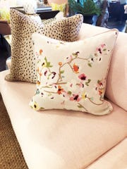 Throw pillows are an inexpensive way to update your home for spring. Bring in patterns and bright light colors to take your year-round furniture into the season. (Handout/TNS)