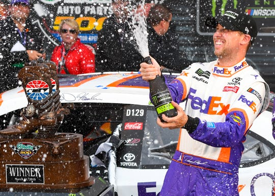 Driver Denny Hamlin celebrates in victory lane after winning a NASCAR Cup auto race Sunday at Texas Motor Speedway.