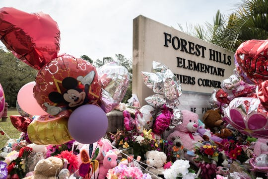 A memorial at the sign of Forest Hills Elementary School in Walterboro, S.C where Raniya Wright, the fifth-grader who died after a fight Wednesday, March 27 attended school.