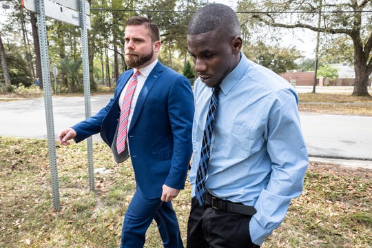 Jermaine Van Dyke, on right, leaves a press conference outside Forest Hills Elementary School in Walterboro, S.C, with his attorney Mark Peper, Apr. 1, 2019. Van Dyke's daughter Raniya Wright, a fifth-grader at the school died last week after a fight with another student.