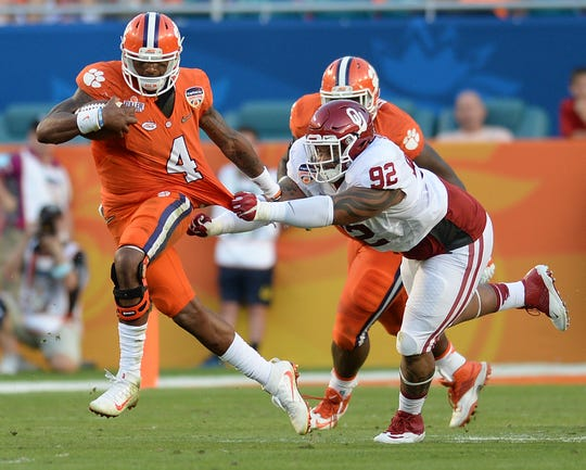 Clemson quarterback Deshaun Watson (4) carries past Oklahoma defensive tackle Matthew Romar(92) during the 2nd quarter of the Orange Bowl Thursday, December 31, 2015 at Sun Life Stadium in Miami Gardens, Fla.