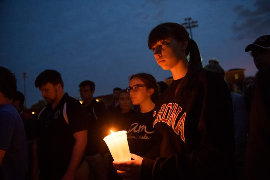 Emily Dotterer, a U of SC sports management sophomore, attends a candlelight vigil with hundreds of other students to honor the life of Samantha Josephson at Strom Thurmond Wellness and Fitness Center Sunday, March 31, 2019.