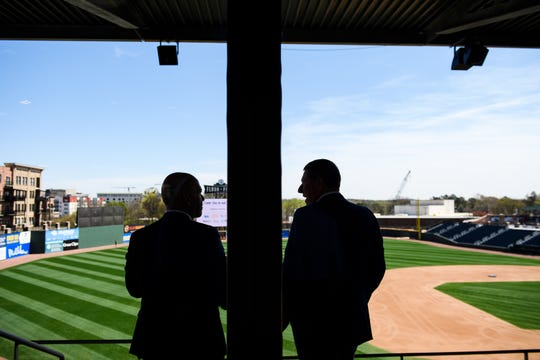 Ben Pingree, director of PLACE, left, and Leon County Commissioner Bryan Desloge speak at Fluor Field in Greenville, S.C. during a Greater Tallahassee Chamber of Commerce trip Monday, April 1, 2019.