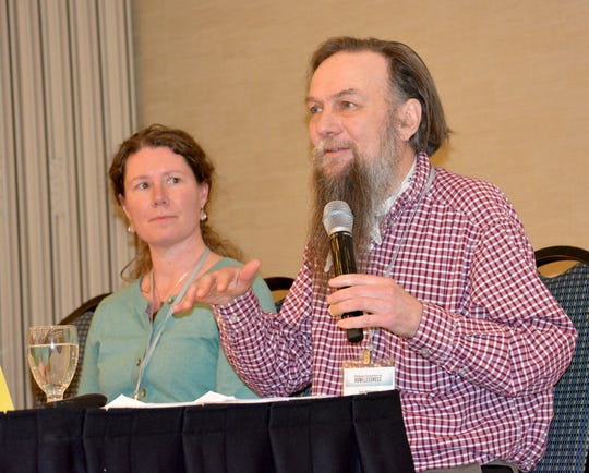 Jim McGrath, right, of the Missoula Housing Authority, speaks at Monday's conference in Helena on homelessness in Montana. With him is Melissa Richards of the Missoula YWCA.