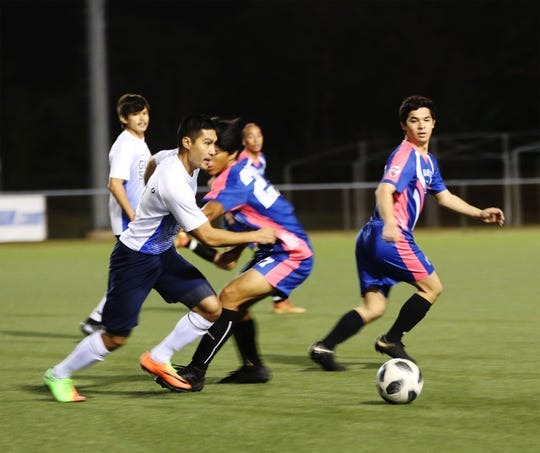 Guam Shipyard's Jan Flores makes his way through the midfield against Lots of Art Tattoo Heat during a Week 18 match of the Budweiser Soccer League Premier Division Saturday at the Guam Football Association National Training Center. The Heat defeated Guam Shipyard 4-2.