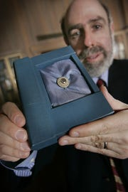 Joel Silver, now director at the Lilly Library, displayed a pendant holding a portion of poet Edgar Allen Poe's hair in 2008.