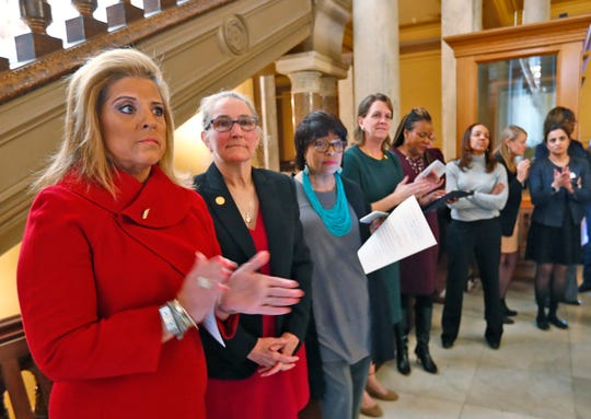 Speakers, including State Representative Mara Candelaria, left, applaud other speakers, before taking their turn to give remarks during a rally at the Indiana Statehouse, Monday, April 1, 2019.  After the Indiana House of Representatives passed a bias crimes statute that does not include protections for characteristics such as sex, gender, identity, and age, Indiana Forward and Women4Change holds a press conference and rally, Monday, April 1, 2019, with women and advocates from around the state to urge Governor Eric Holcomb, Senate Pro Tempore Rodric Bray, and Sen. Mike Bohacek to dissent on Senate Bill 198 so that the missing characteristics can be added in conference committee.