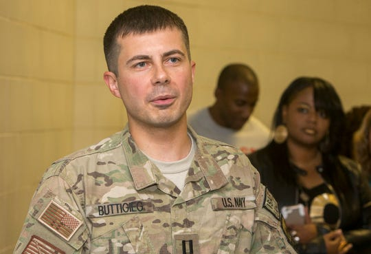 South Bend Mayor Pete Buttigieg speaks to family and friends Thursday, September 25, 2014, at Concourse A at South Bend International Airport in South Bend after returning from a seven-month tour serving in the U.S. Navy in Afghanistan. SBT Photo/GREG SWIERCZ