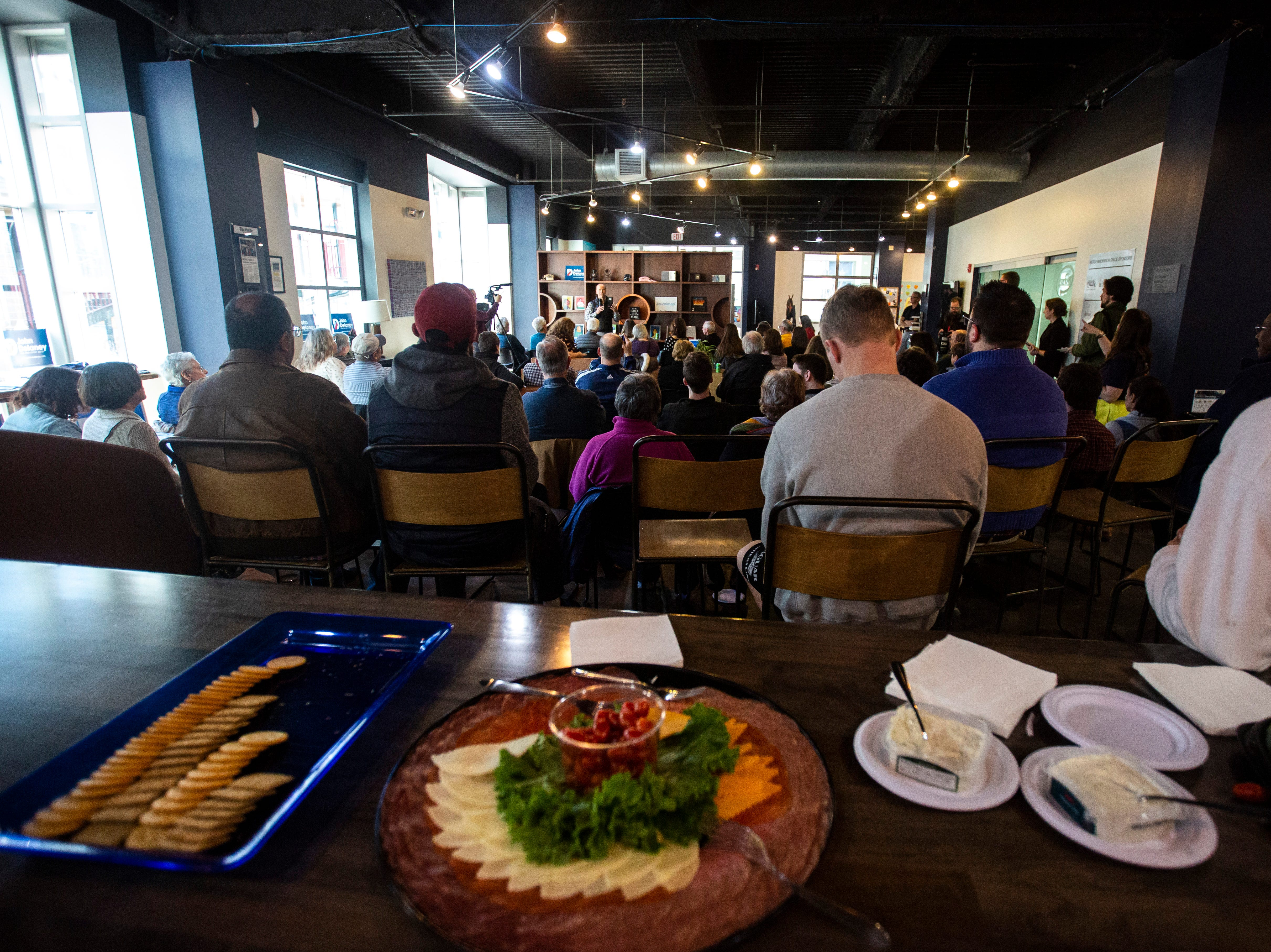 Democratic presidential candidate John Delaney speaks during an event on Sunday, March 31, 2019, at MERGE, a coworking space in downtown Iowa City, Iowa.