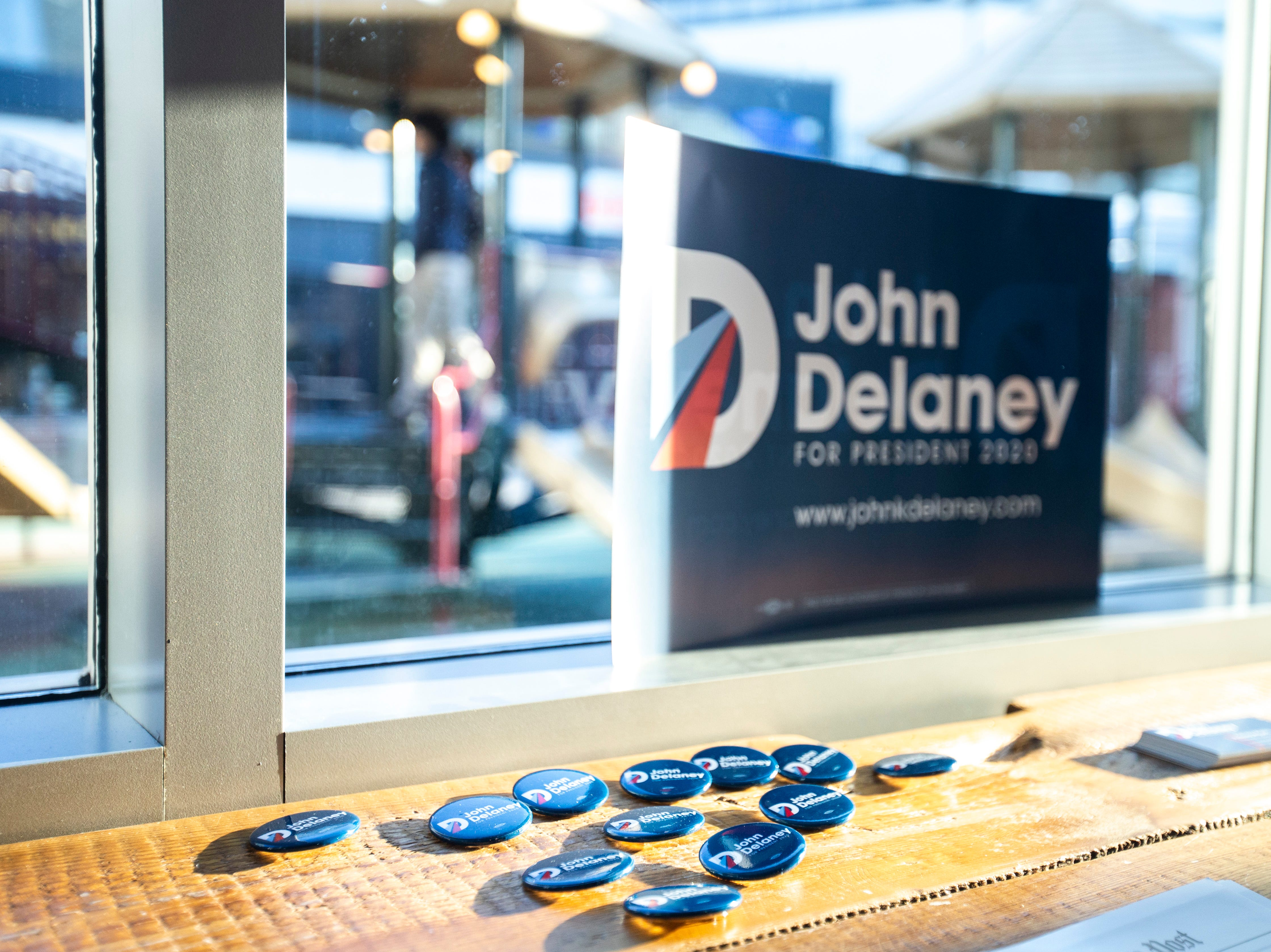 Buttons sit out for Democratic presidential candidate John Delaney during an event on Sunday, March 31, 2019, at MERGE, a coworking space in downtown Iowa City, Iowa.