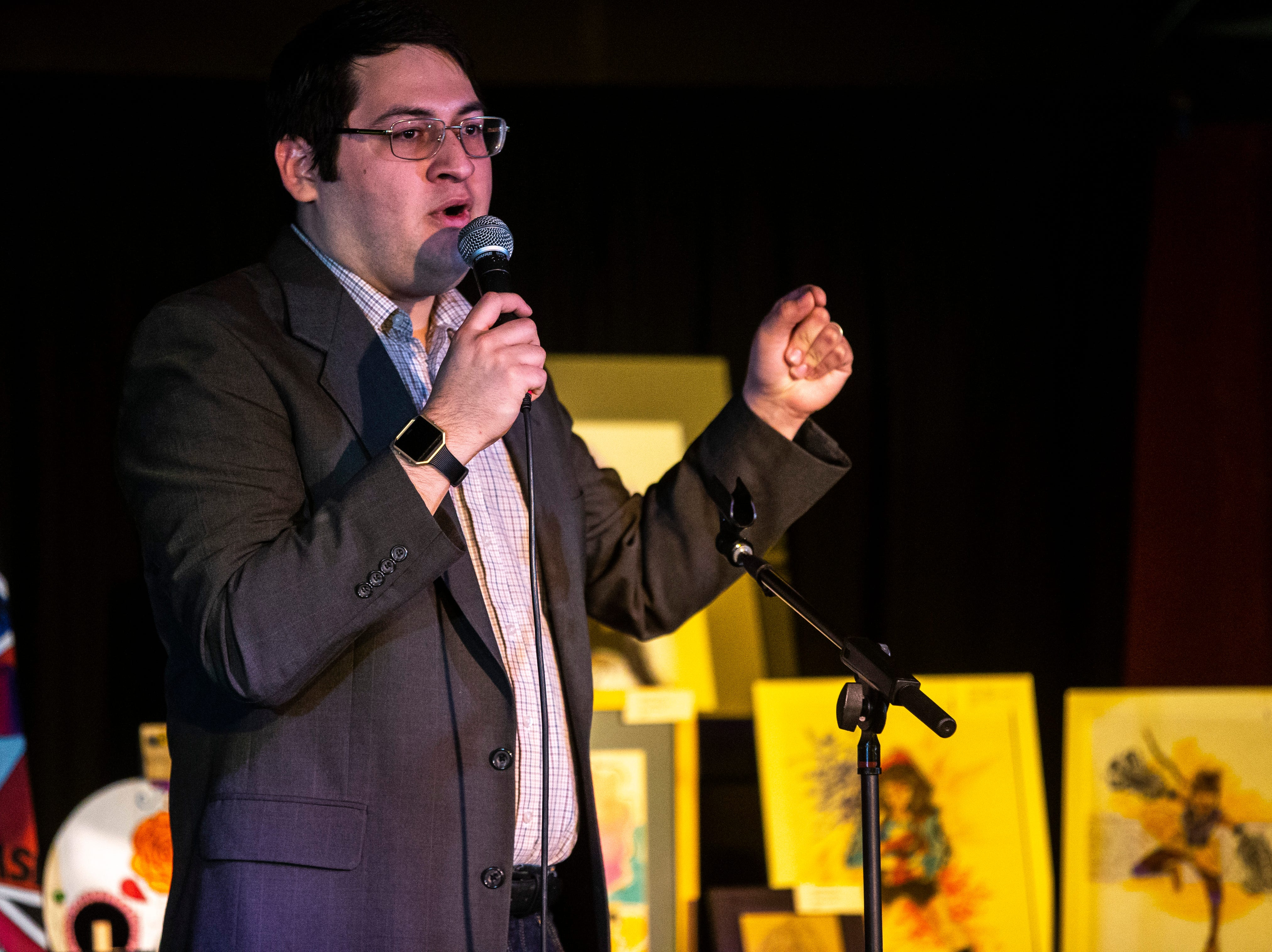 Jonathan Munoz, president of LULAC Council 308, speaks during a Lotería game night hosted by the council on Sunday, March 31, 2019, at The Mill in downtown Iowa City, Iowa.