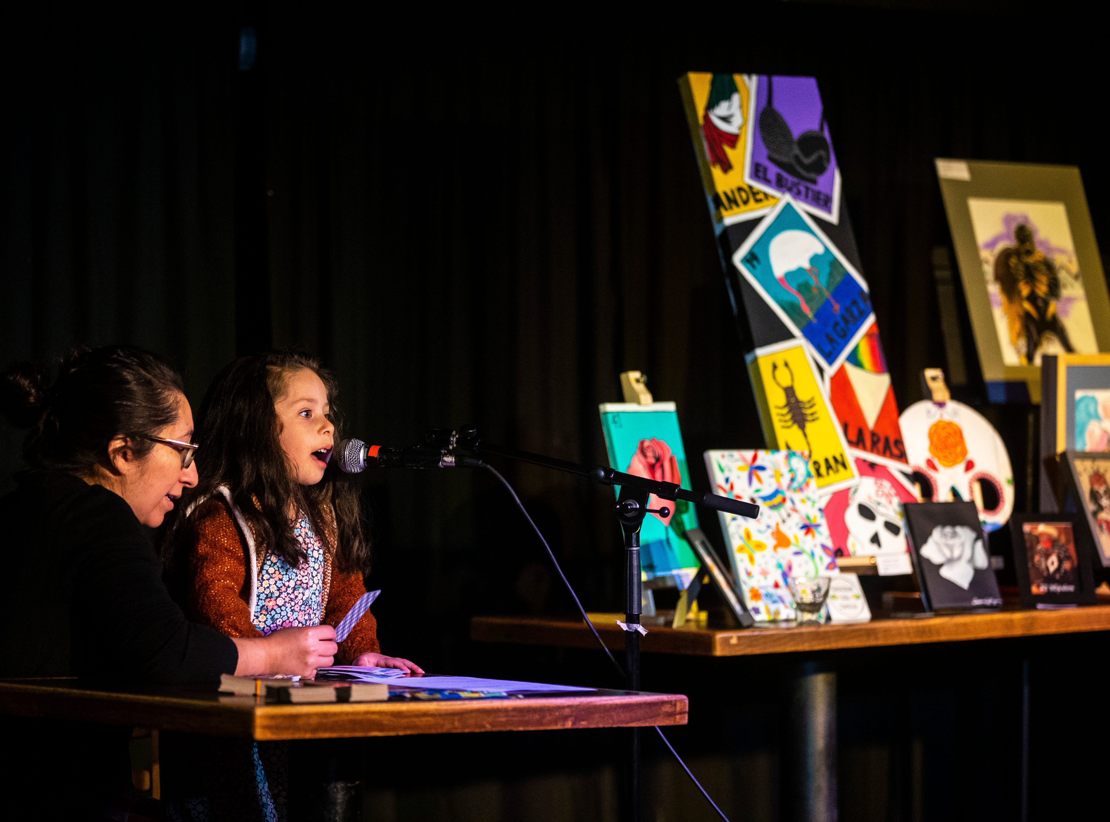 Paloma Bribriesco, 4, calls out cards during a Lotería game night hosted by LULAC Council 308 on Sunday, March 31, 2019, at The Mill in downtown Iowa City, Iowa.