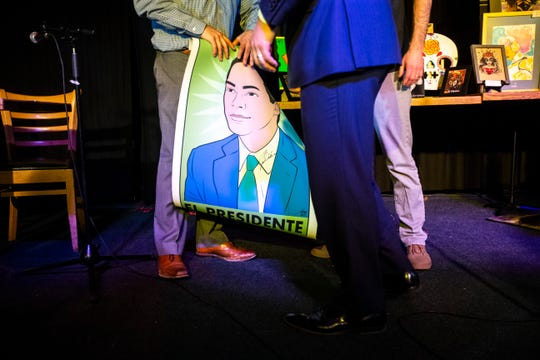 Democratic presidential candidate Julián Castro meets with members of the LULCA Council 308 after a Lotería game night on Sunday, March 31, 2019, at The Mill in downtown Iowa City, Iowa.