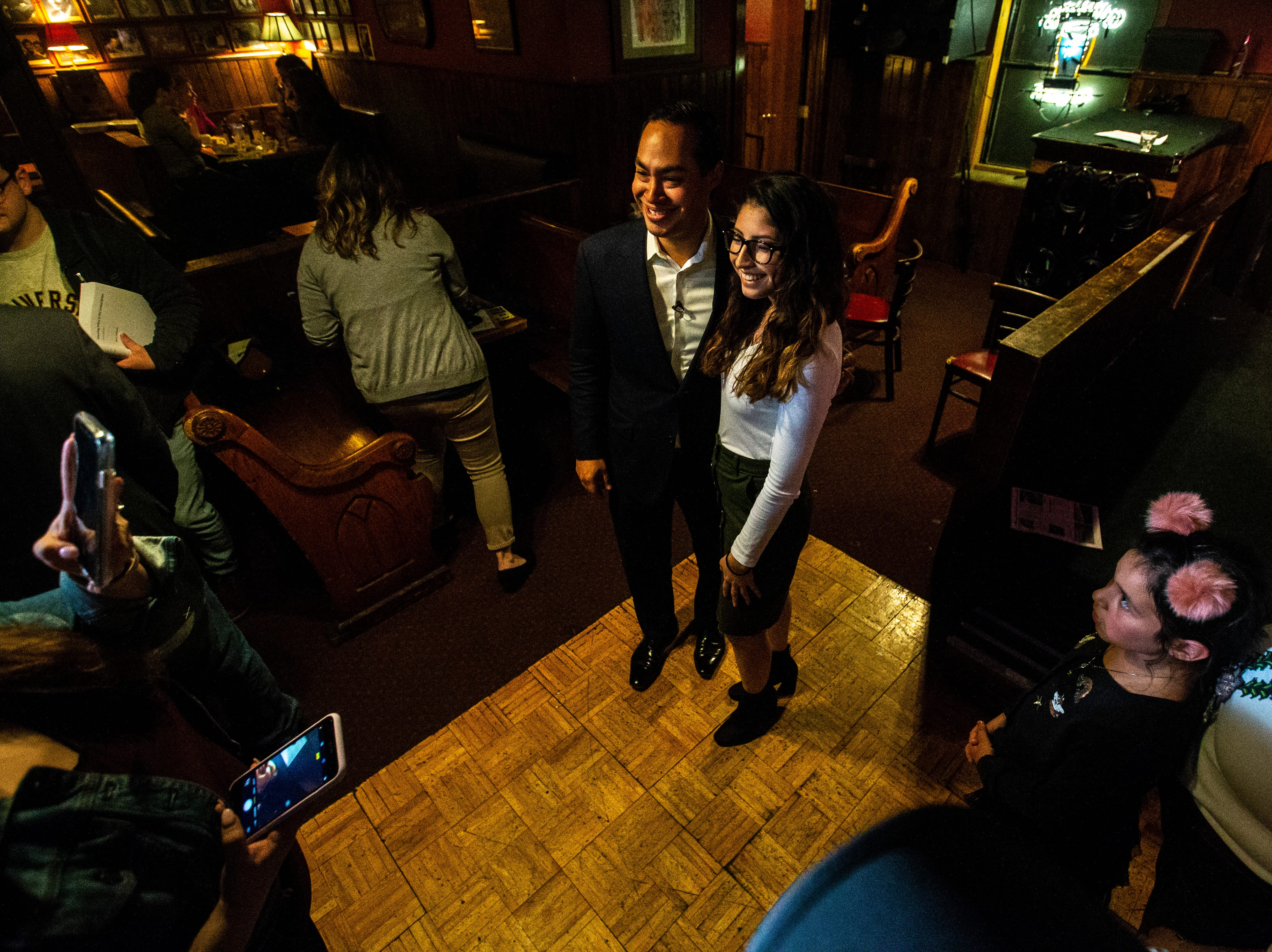 Democratic presidential candidate Julián Castro takes photos with supporters after a Lotería game night hosted by LULAC Council 308 on Sunday, March 31, 2019, at The Mill in downtown Iowa City, Iowa.
