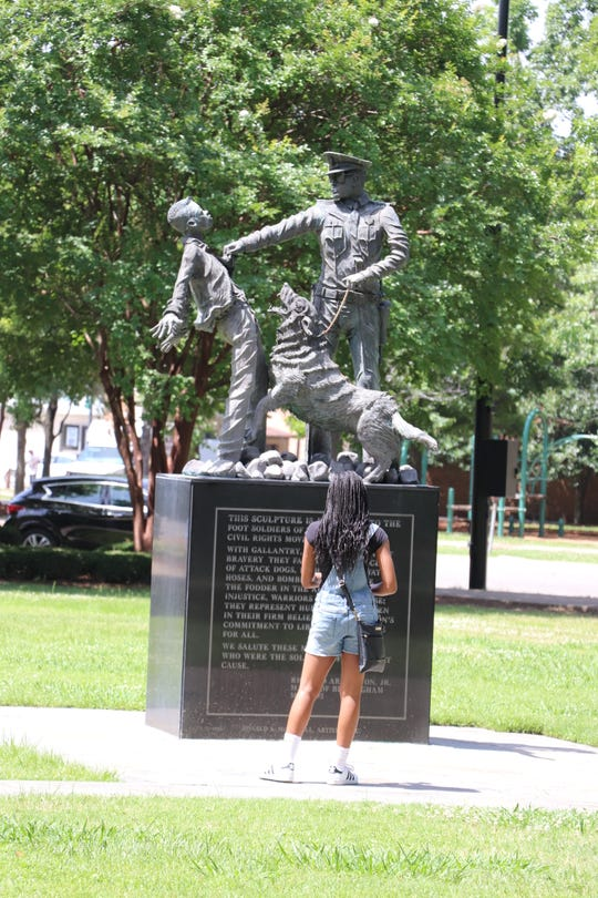 "As part of the FasTrac 10th Anniversary Civil Rights HBCU Tour, students visited Kelly Ingram Park. Among them is the ""Foot Solider"" statue."" Based on an iconic photo taken during a demonstration in 1963, the statue has recently been the subject of criticism by writer Malcolm Gladwell for its distortion of elements in the original photograph."