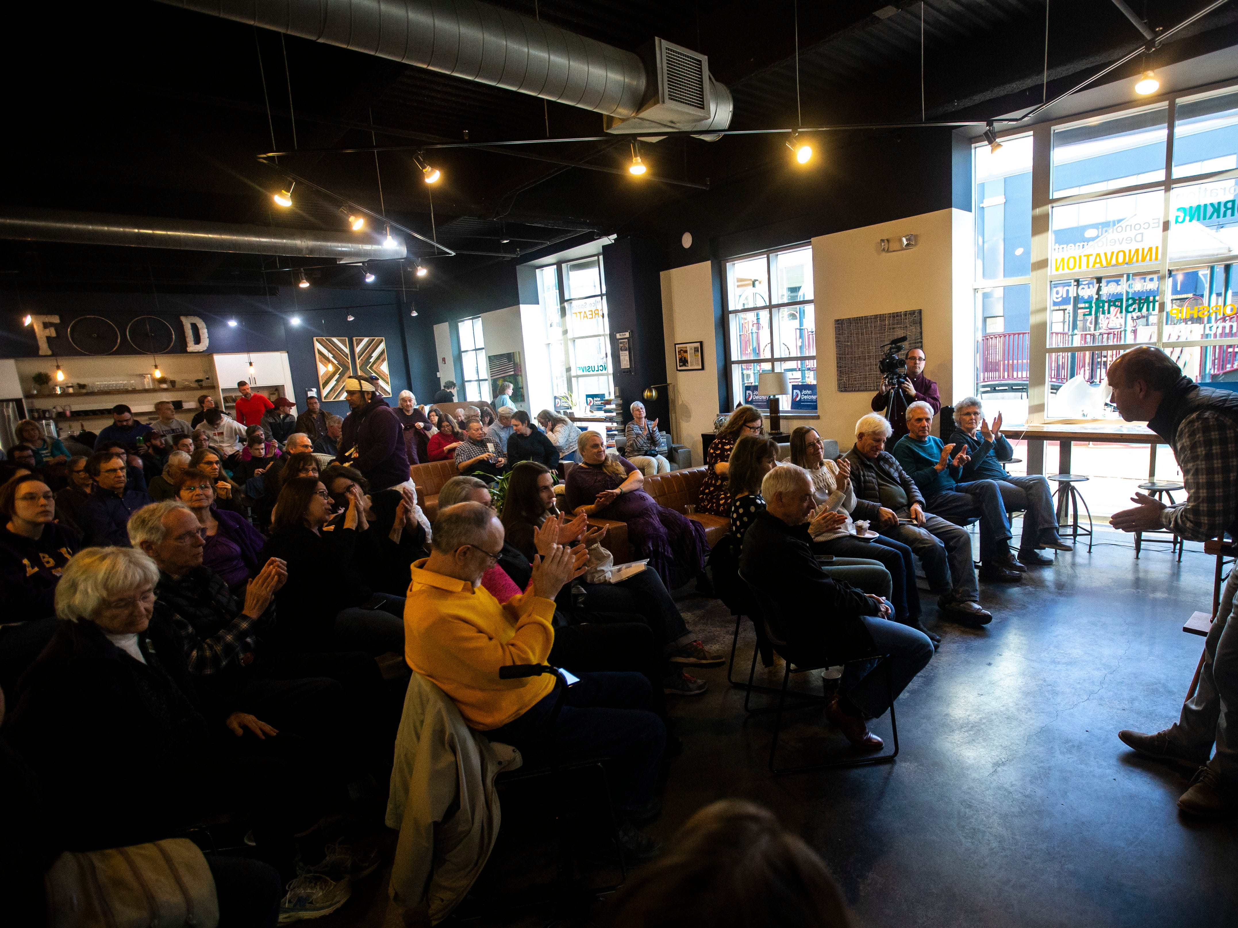 Democratic presidential candidate John Delaney is acknowledged by the crowd after speaking during an event on Sunday, March 31, 2019, at MERGE, a coworking space in downtown Iowa City, Iowa.